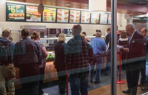 Diners wait in line at a Subway sandwich shop on September 15, 2015 in Chicago, Ill. Subway will serve antibiotic-free turkey and chicken by the end of 2016, but it may take nine years for its suppliers of beef and pork to go antibiotic-free as well